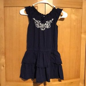Navy dress with white embroidery. Cap sleeves